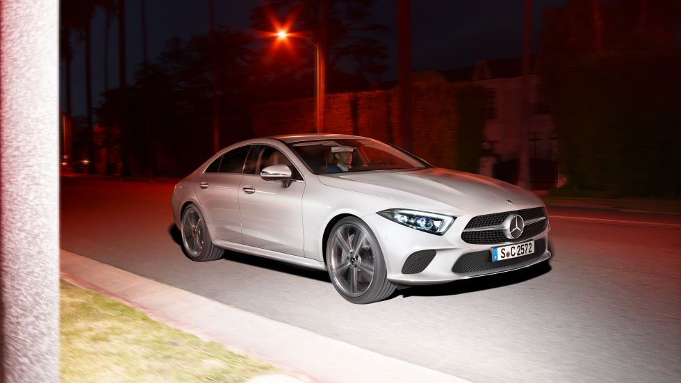 The photo shows the Mercedes-Benz CLS from the side front.